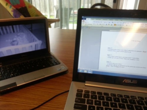 My view while I write.  Can you spot my daughter napping (see the small screen)?
